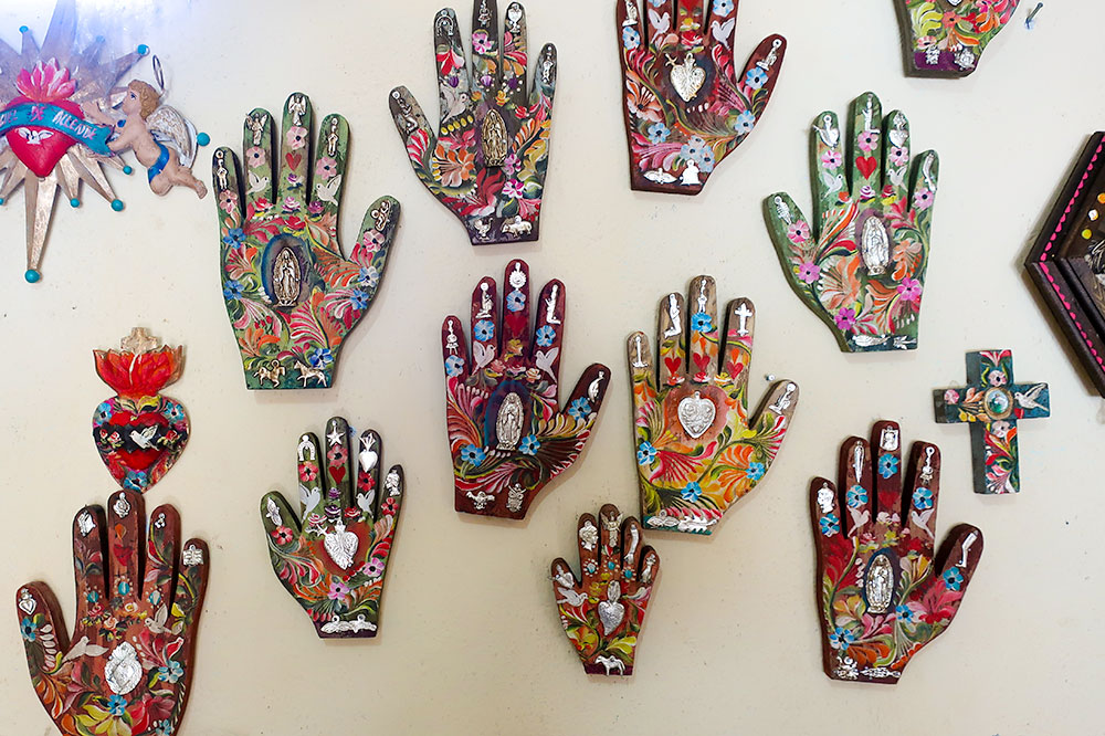 Hand-painted sacred hearts, crucifixes and hands at San Martín de Porres in San Miguel de Allende