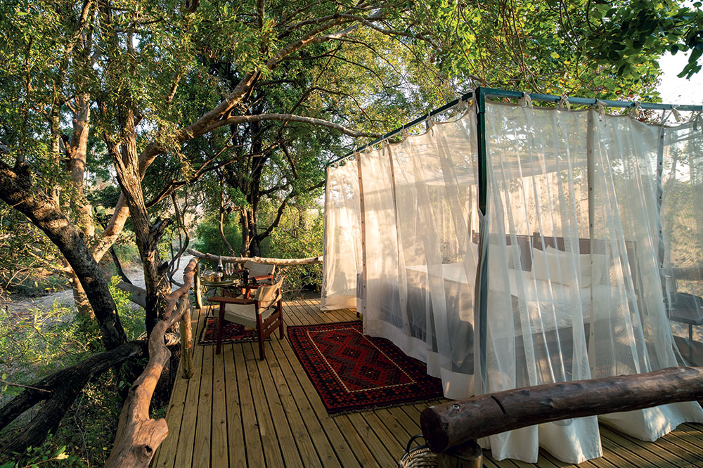 An open-air bed at Sapi Springs Camp in the Sapi Reserve in Zimbabwe