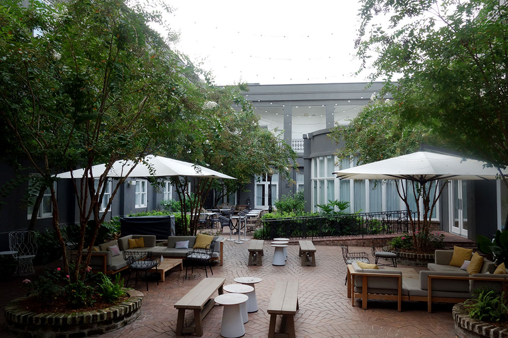 The courtyard terrace of The Kimpton Brice Hotel