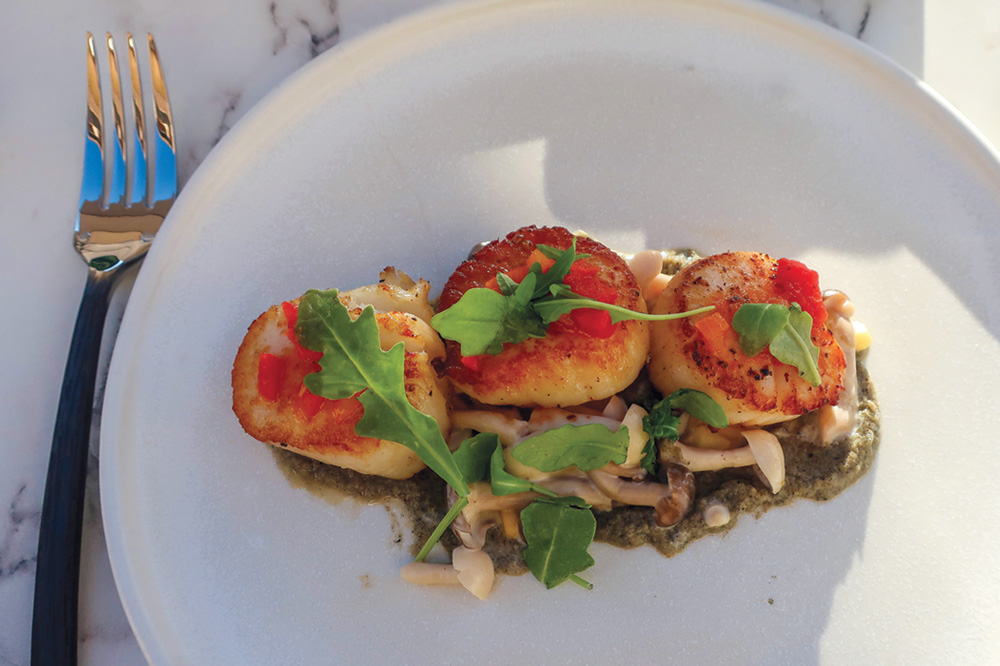 Roasted sea scallops with sweet corn ragout, piperade, pickled shimeji mushrooms and eggplant brûlée at The Lodge at Blue Sky