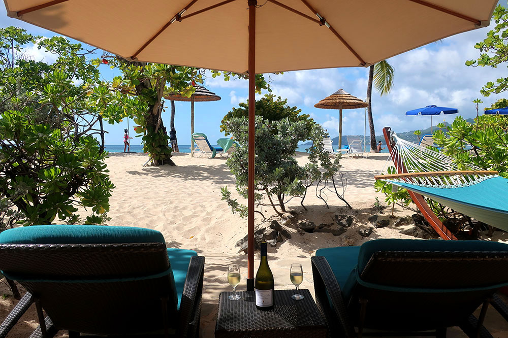 Lounge chairs on the patio of our Seagrape Beach Suite at Spice Island Beach Resort