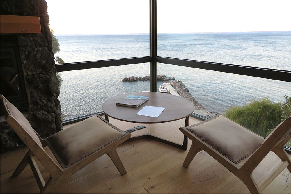 A seating area with a view from our suite at Hotel AWA in Puerto Varas