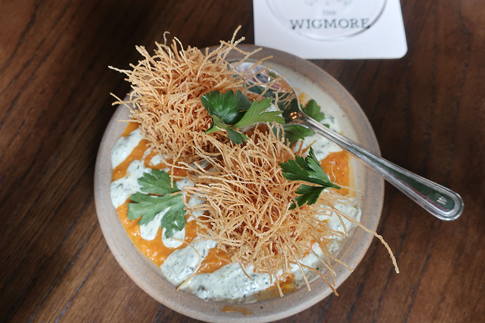 Masala-spiced Scotch eggs with dal and herbed yogurt sauce from The Wigmore