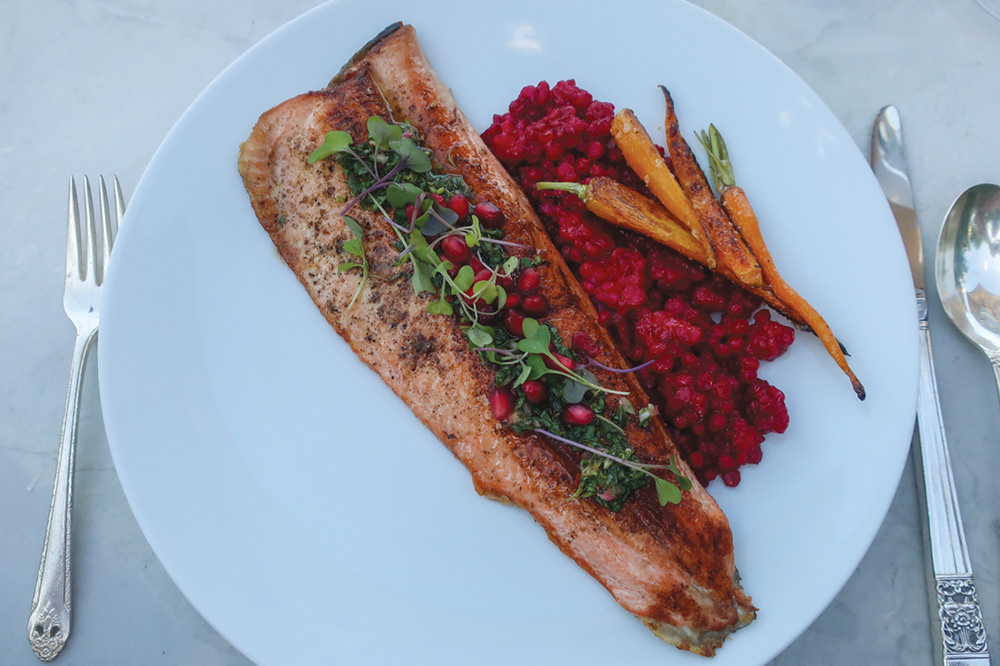 Steelhead trout with pomegranate chimichurri, Israeli couscous cooked in beet juice, and fresh local carrots at the Washington School House Hotel