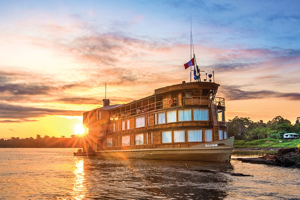 Lindblad National Geographic Expeditions' <em>Delfin II</em> sailing through the Upper Amazon