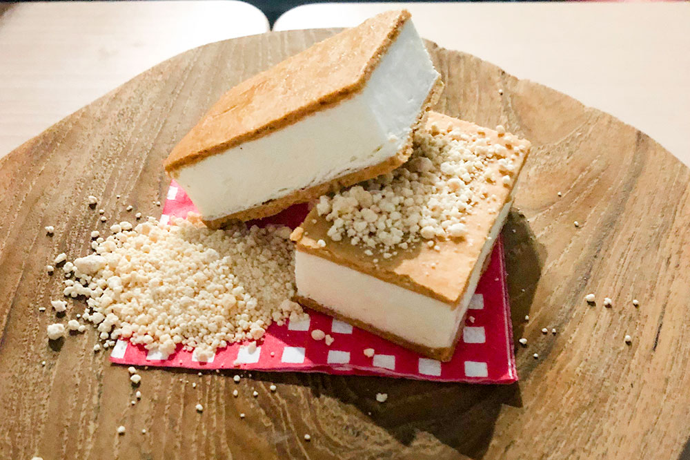 "Buttermilk-semifreddo-stuffed gingerbread sandwich with white chocolate ""sand"" from Upper Bloem"