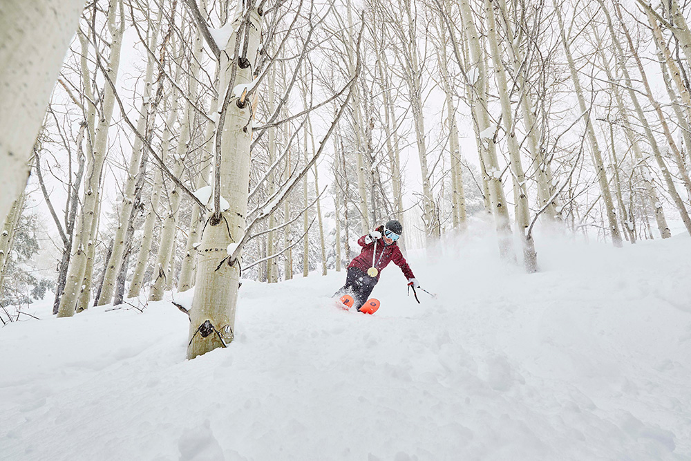 Skiing through aspen trees at Vail