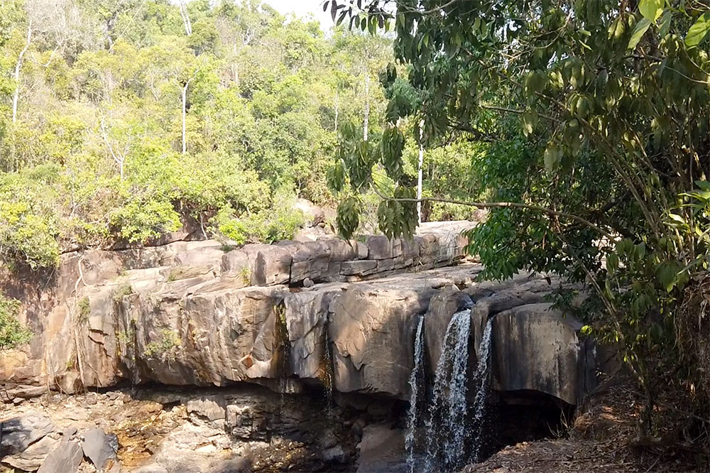 A view of the waterfall from the public spaces at Shinta Mani Wild