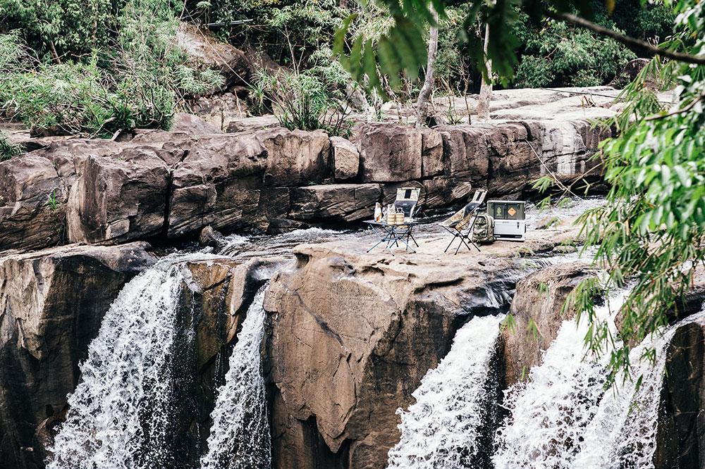 A picnic on a waterfall at Shinta Mani Wild