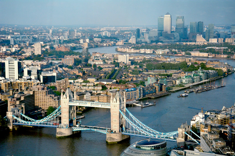 View of East London, downstream, Tower Bridge and Canary Wharf business district