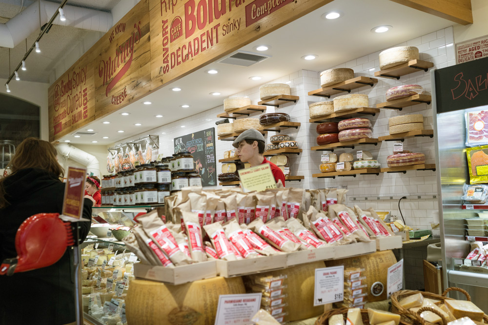 Selection of cheeses and condiments at Murray's Cheese Shop in New York