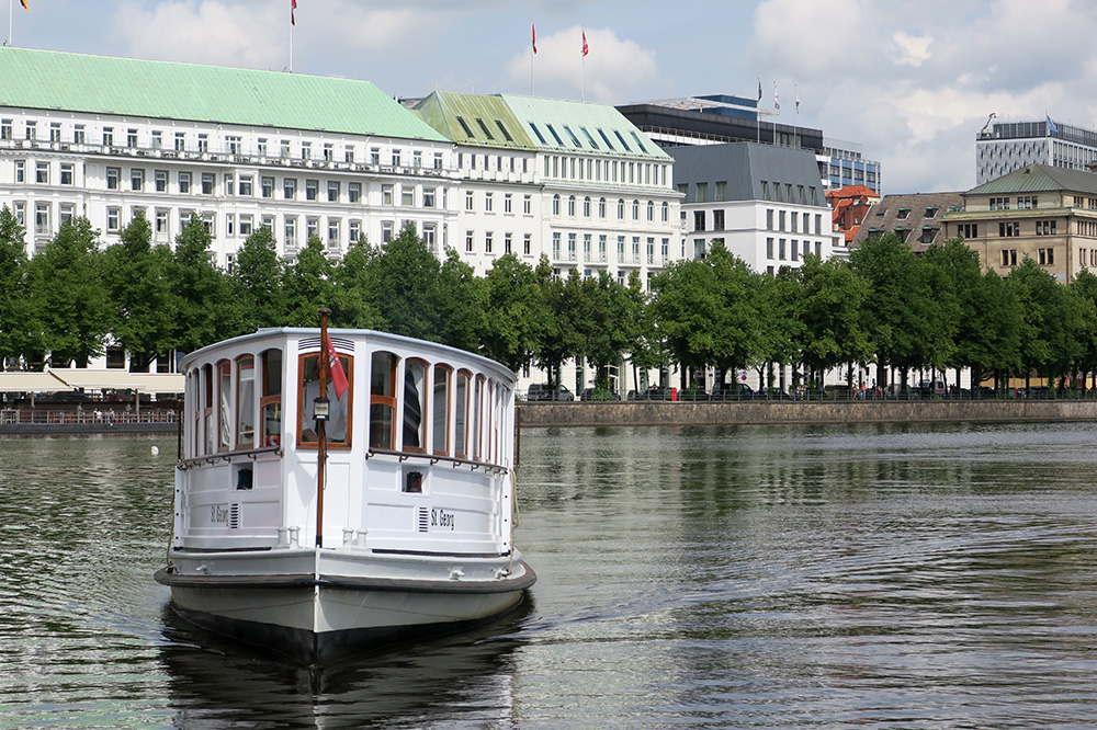 The <em>St. Georg</em>, the boat that took us on our Alster cruise, approaching the jetty in Hamburg, Germany