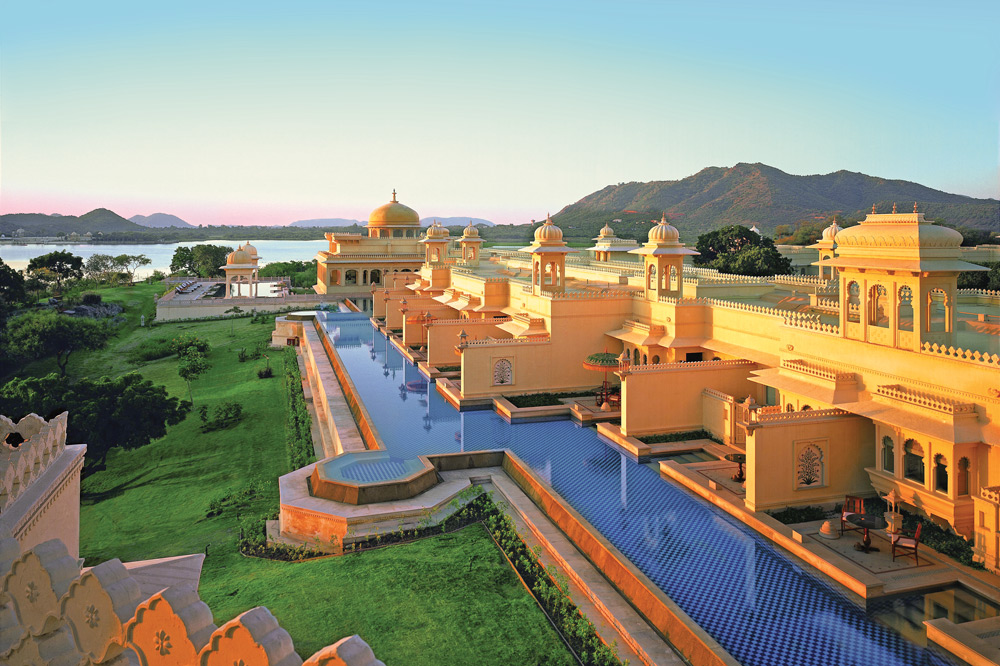 Sunrise over the deluxe rooms with semi-private pool at the ultra-luxurious Udaivilas Oberoi Hotel in Udaipur, India