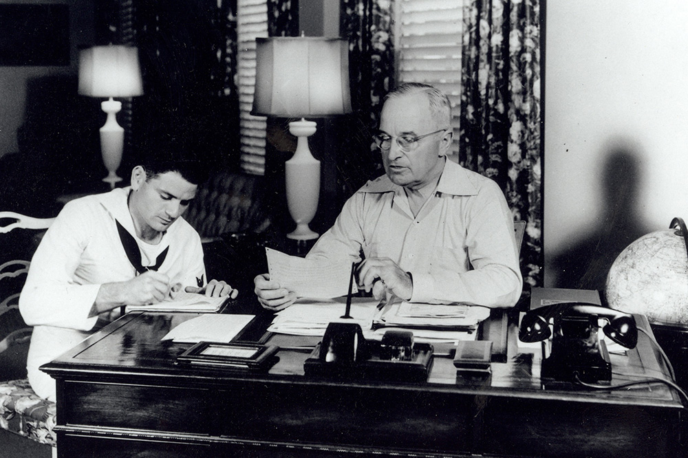 An archival photo of President Harry S. Truman working at the Truman Little White House in Key West, Florida - US Navy/ Truman Little White House Collection