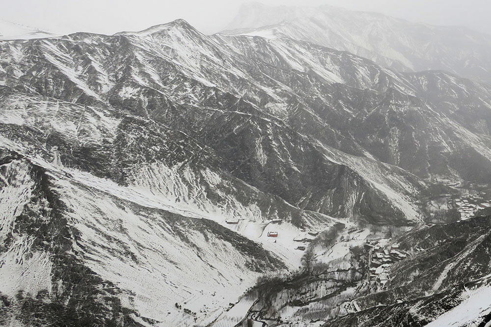 The view from the Tizi n'Tichka pass during a snowstorm in the Atlas Mountains