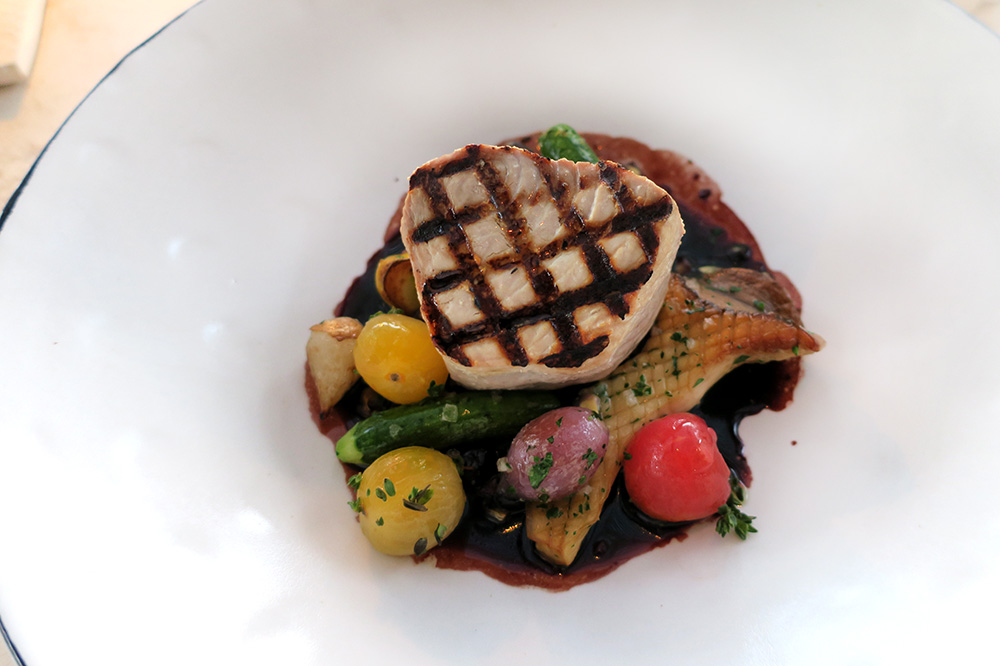 The tuna steak with fermented purple corn, hen of the woods mushrooms and toy-box tomatoes from <em>COMAL</em> at Chileno Bay Resort in Los Cabos, Mexico - Photo by Andrew Harper