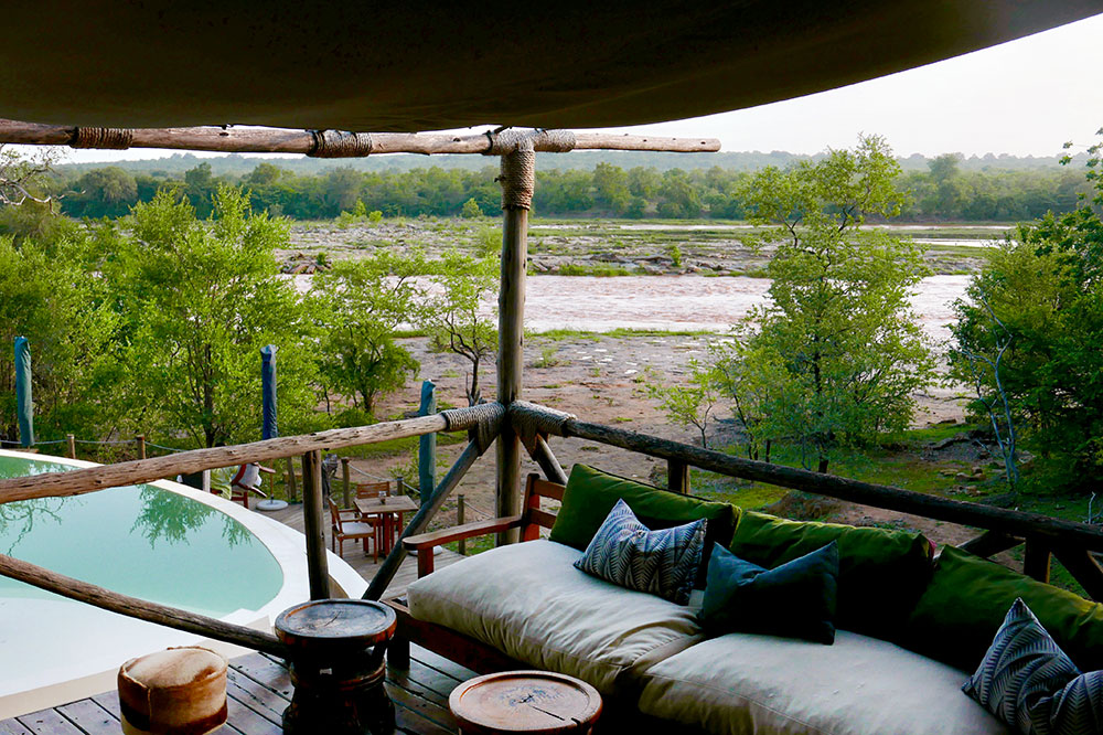 A view of the pool and Rufiji River at Azura Selous in the Selous Game Reserve