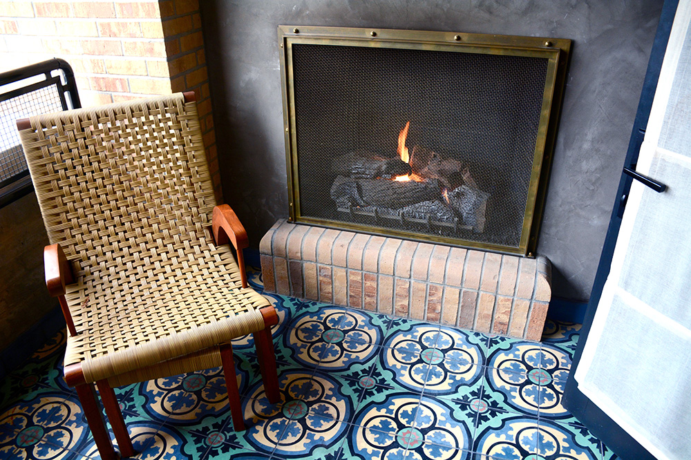 The outdoor gas fireplace off our Terrace Room at Hotel Emma - Photo by Andrew Harper
