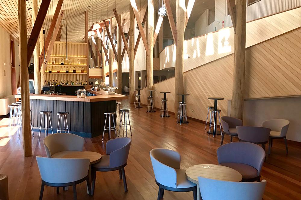 The hotel's interior and the bar at explora Valle Sagrado