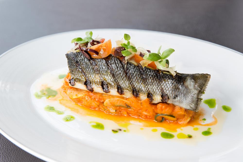 Charred sea bass with lavender verjus at <em>Café Gray Deluxe</em>