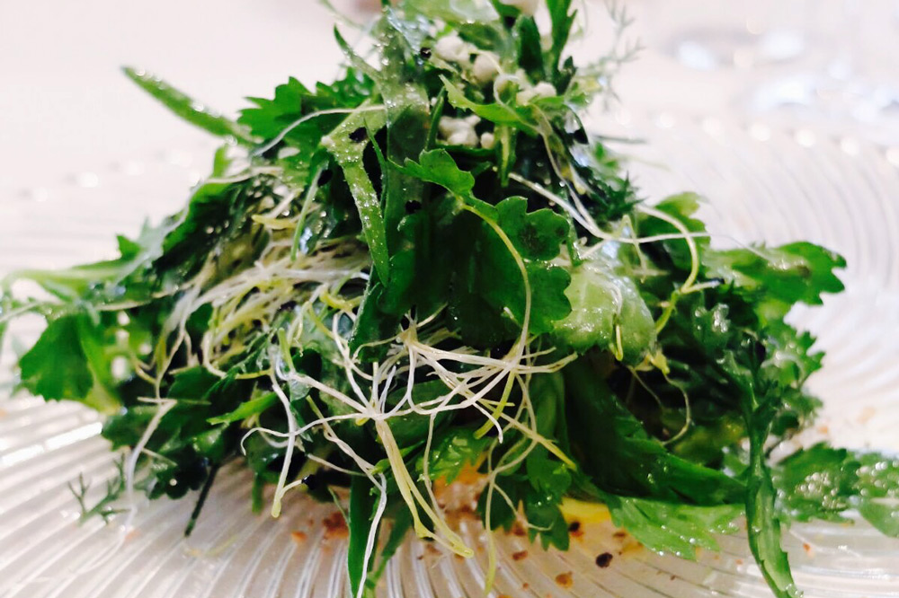 Bitter herbs salad, crunchy almond and anchovies, pollen and mana at <em>L'Arcangelo</em>