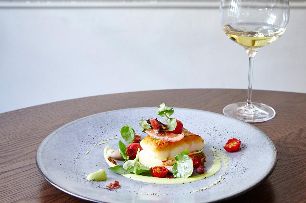 Lightly salted Icelandic cod, avocado, brandade, tomatoes and chorizo at <em>Texture</em>