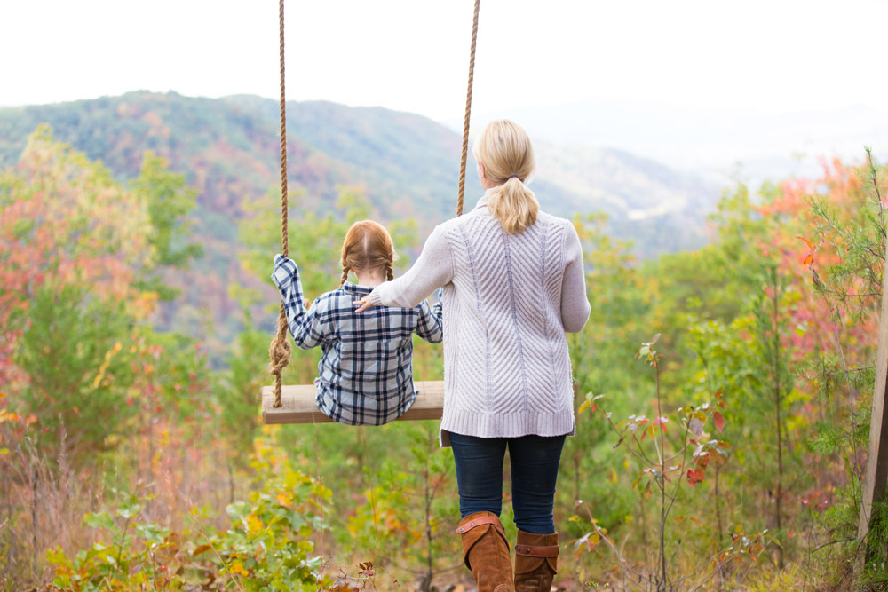 A woman and child enjoy the view from the land that will be Blackberry Mountain