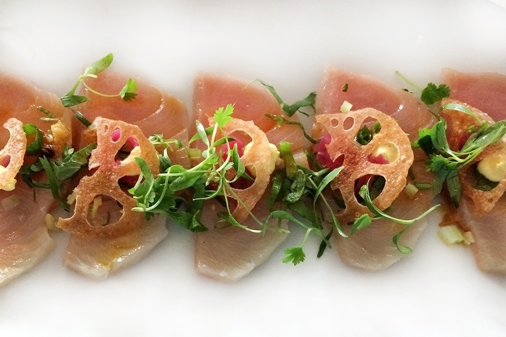 Hamachi tiradito with Peruvian chiles, onion and lotus root at <em>Buccan</em>