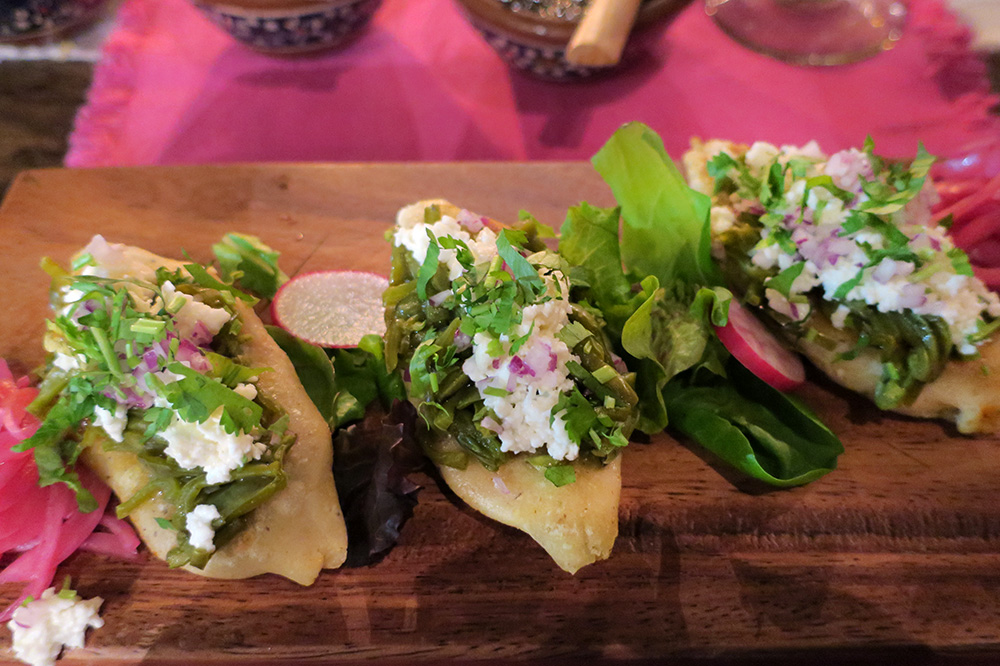 Chicharrón-filled tlacoyos topped with cactus, fresh cheese and pickled red onions from <em>Restaurante Los Tres Gallos</em> in Cabo San Lucas, Mexico - Photo by Andrew Harper