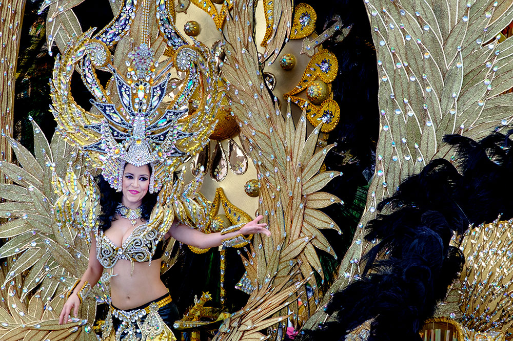 A woman in a lavish costume at Carnival in Santa Cruz de Tenerife on the Canary Islands, Spain
