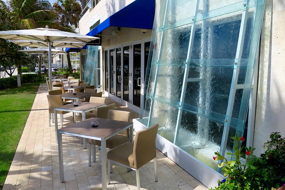 Outdoor seating at <em>Chanson</em> restaurant at Royal Blues Hotel