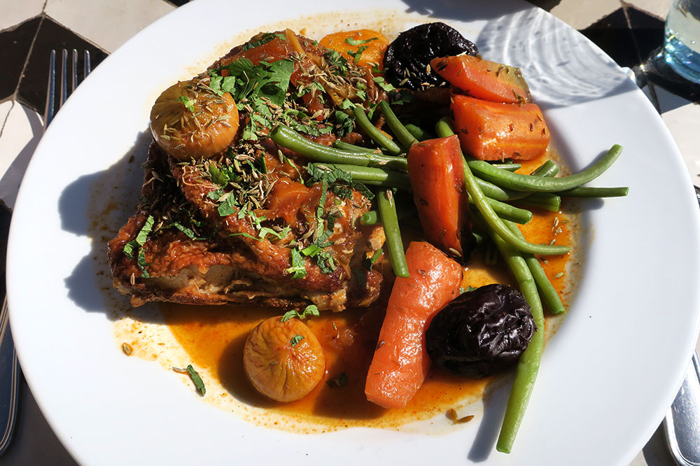 A chicken tagine with apricots, dates, carrots, green beans, lemon, ginger and saffron from <em>Nomad</em>