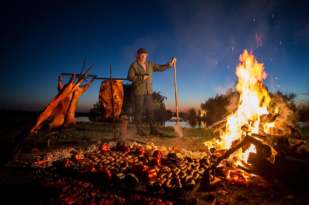 Mallmann cooking over an open flame