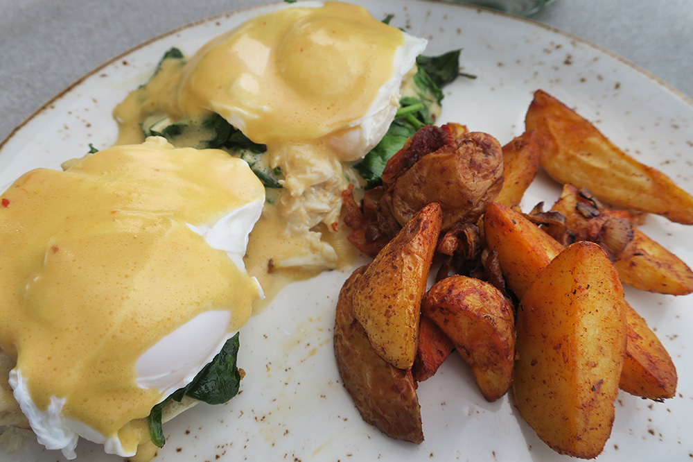 Crab Benedict with chipotle Hollandaise, spinach and paprika-roasted potatoes from Esperanza in Los Cabos, Mexico - Photo by Andrew Harper
