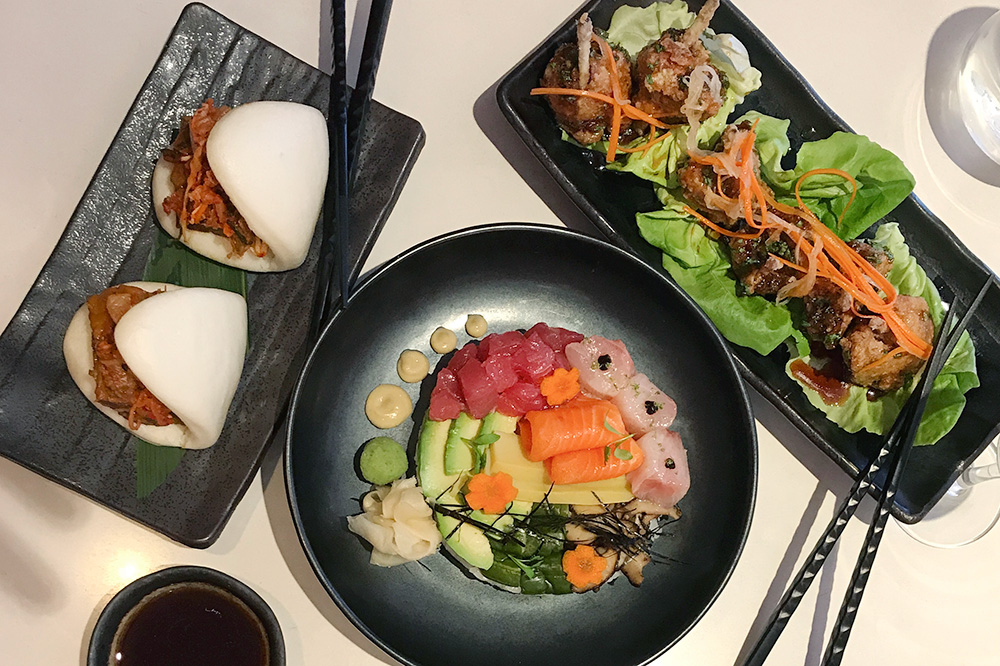 Short rib buns with kimchi, a chirashi bowl and chicken wings with sweet-spicy hoisin sauce from <em>Departure</em> in Denver, Colorado
