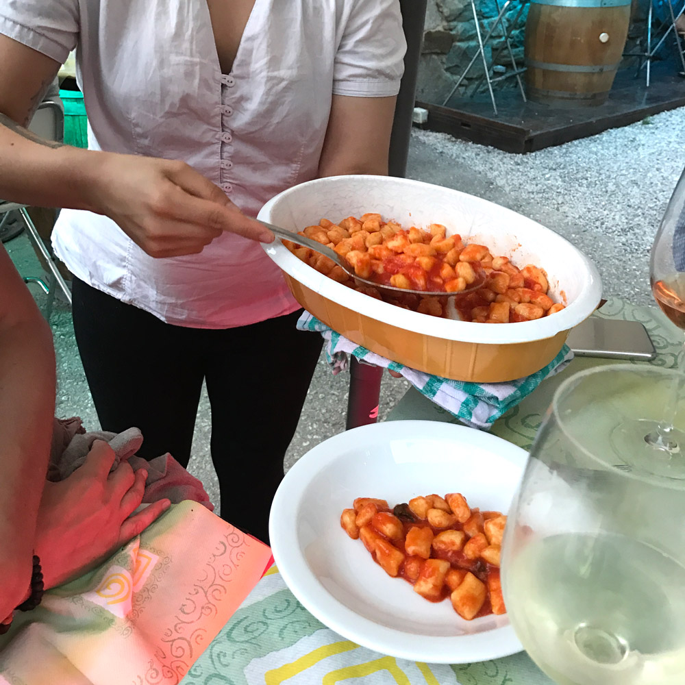 Serving terrific gnocchi on the terrace overlooking the mountains and town at Rifugio L'Arbergh in Palanfré - Betsy Andrews