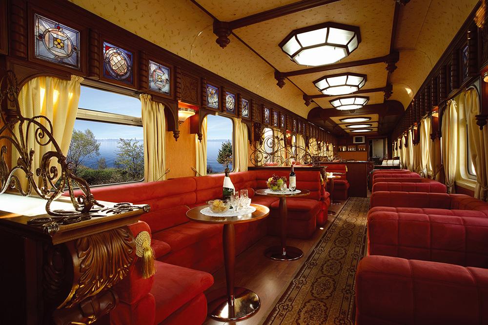 The bar car lounge on Golden Eagle Luxury Trains' <em>Trans-Siberian Express</em>