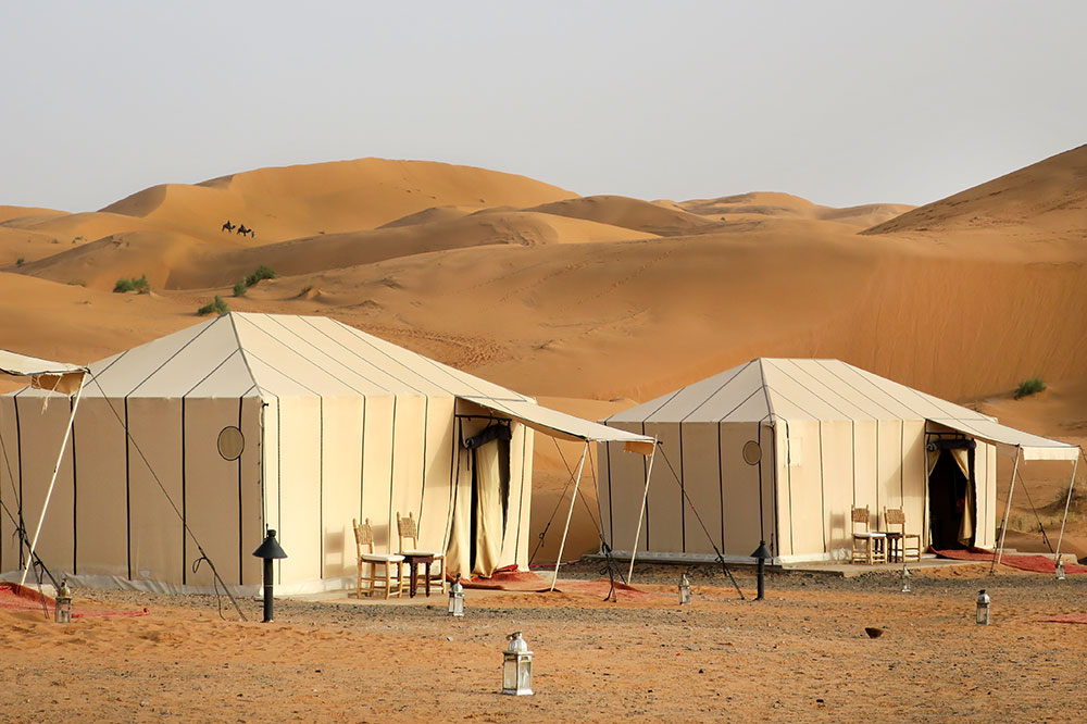 The exterior of the guest tents at Merzouga Luxury Desert Camps in Merzouga, Morocco