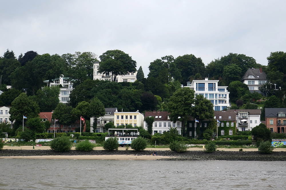 Villas along the Elbe River, seen from our Hafenrundfahrt XXL cruise in Hamburg, Germany