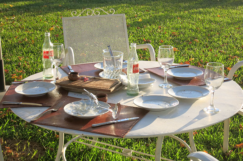 Table by the pool that remained uncleared for hours at House of Jasmines