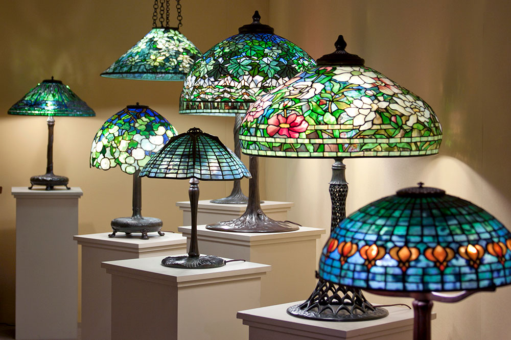 The interior of the gallery displaying a variety of Tiffany Studios designs at Lillian Nassau