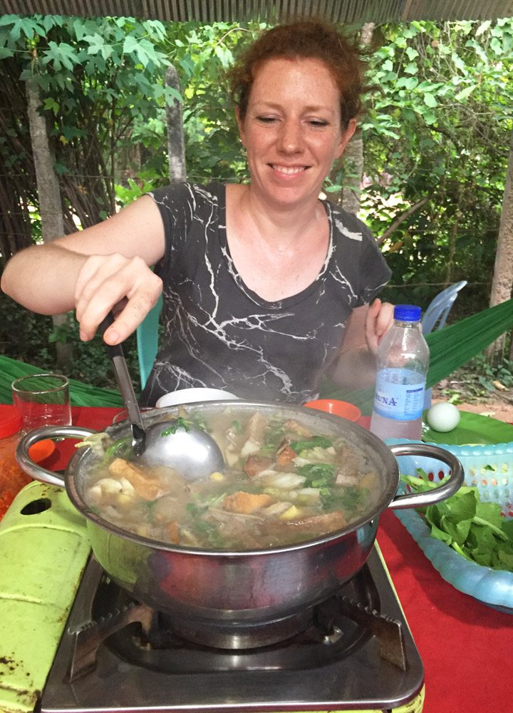 Our tour guide stirring the large pot of duck soup at <em>Muscovy Duck Soup</em>