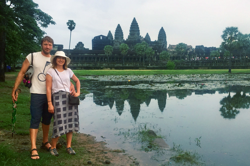 Kristen and her husband in front of the Temple at Angkor Wat at sunrise