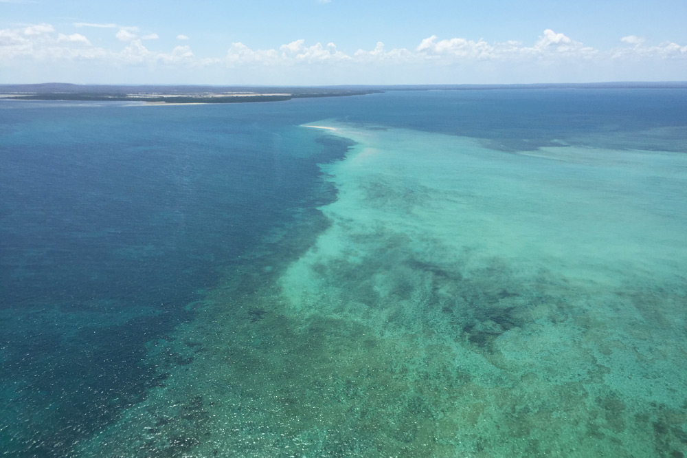 View of the water from the helicopter ride to Azura Quilalea