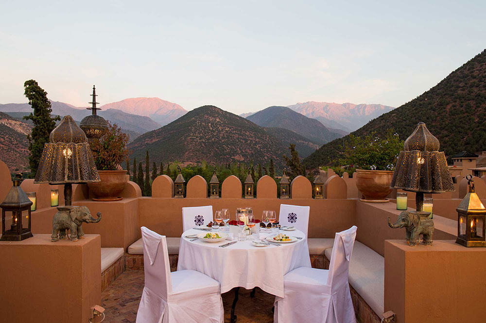 Roof-terrace dining at Kasbah Tamadot in Asni, Morocco