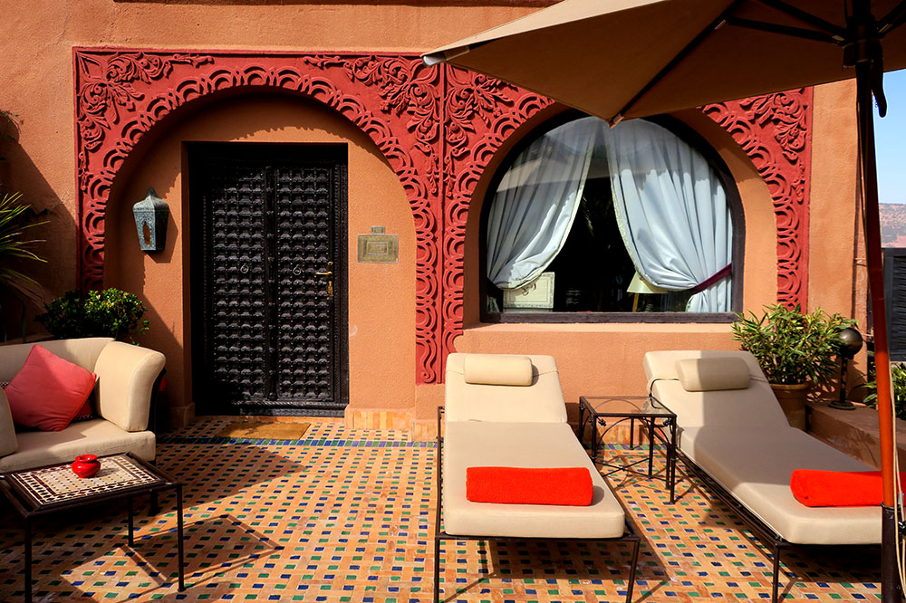 The exterior and seating area of our Deluxe Suite at Kasbah Tamadot in Asni, Morocco