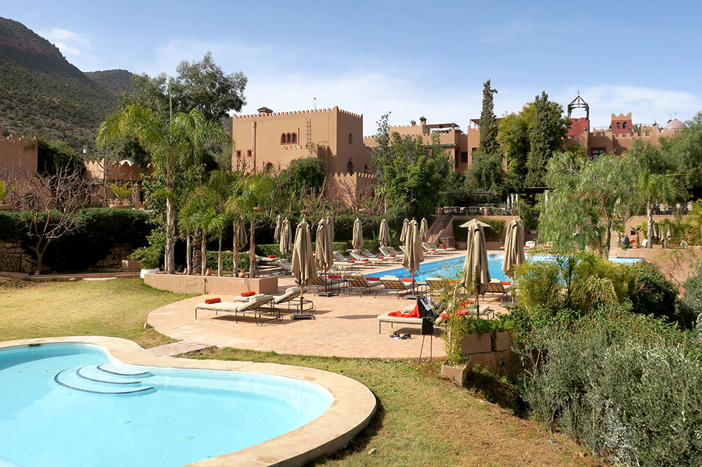 The hot tub, pool and hotel exterior of Kasbah Tamadot in Asni, Morocco