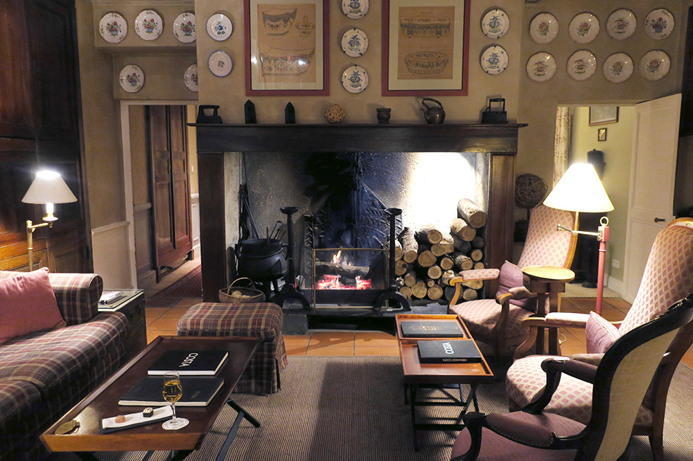 A glass of Monbazillac wine by the fire in the lounge at Le Vieux Logis in Trémolat, France