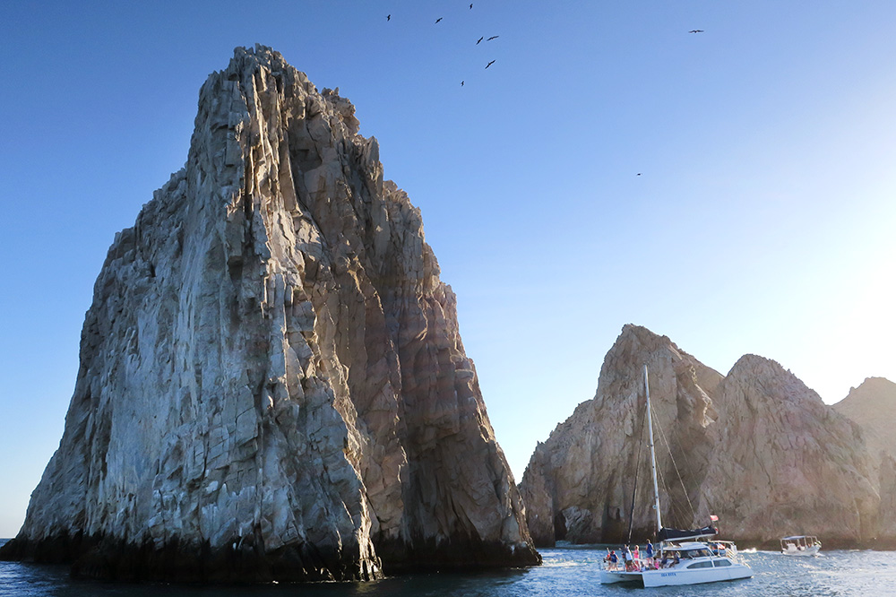 The Los Arcos rock formations from the <em>Tropicat</em> catamaran on our sunset cruise in Cabo San Lucas, Mexico