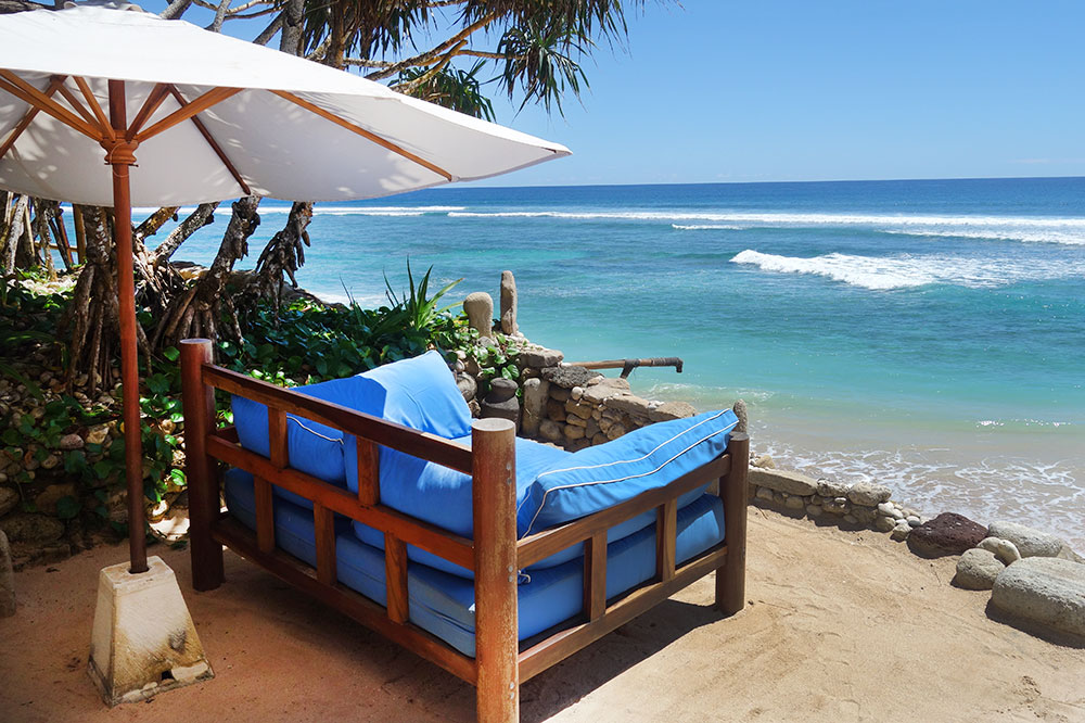 Lounge chairs on the beach at Nihi Sumba